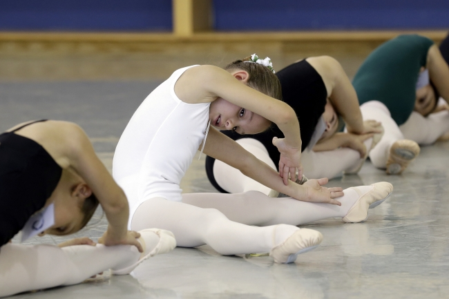 Cristina Rabasso, center, stretches with other hopeful students during an audition for seven to nine-year-olds for classes at the Miami City Ballet School, Saturday, Aug. 10, 2013 in Miami Beach, Fla.