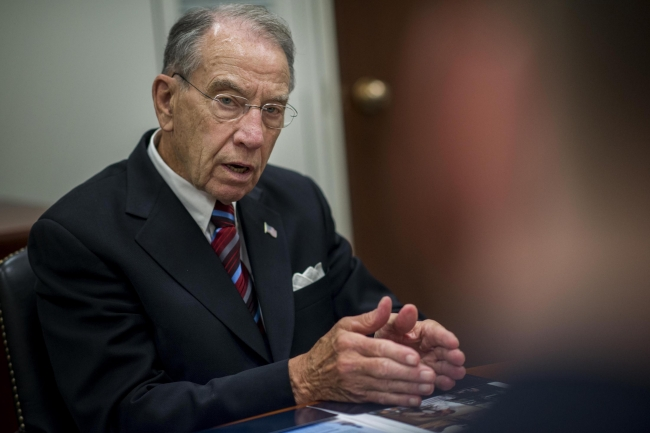 Senator Chuck Grassley meets with staff in his office on Capitol Hill.